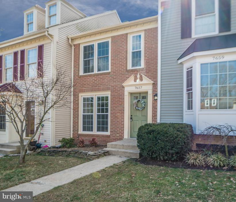 Charming and updated!  This spacious, 2BR, 2.5BA, brick front town home features: NEW windows; NEW kitchen cabinets, granite counter tops and stainless steel appliances; newly installed flooring throughout; updated master bath; and freshly painted!