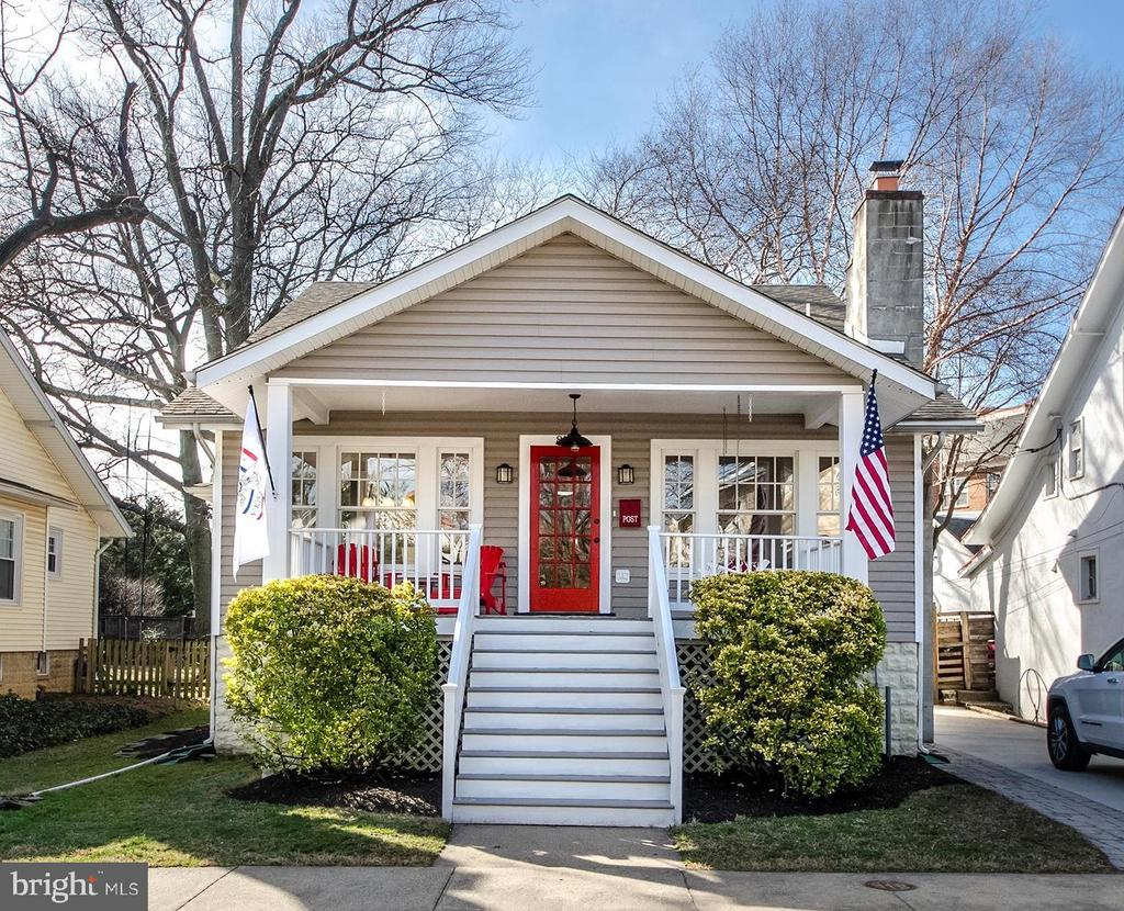 """A jewel box in the heart of Clarendon!  The seamless expansion and remodel by BCN Homes to this quintessential Arts and Crafts Bungalow will melt your heart.  With a Walk Score of 93, this stellar Metro'centric locale is in the epicenter of Orange Line enticements.  Enjoy the """"iced tea sipping"""" front porch, 3 finished levels, open & airy, totally turnkey living space, gleaming Heart Pine flooring, 3 bedrooms+den, 3 full baths, living room with cozy wood burning fireplace, enchanting light-filled dining room, gourmet granite/stainless kitchen with breakfast bar opening to the adjoining family room, convenient main level bedroom & freshly updated bath, expanded upper level with spacious bedrooms, master with walk closet and convenient upper level laundry, finished lower level complete with recreation room, den/guest room and loads of storage. All on a perfectly level fenced garden lot with paver patio and amazing screened porch for outdoor enjoyment."""