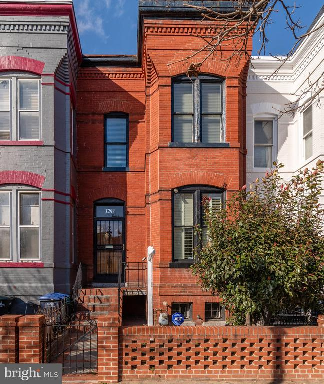 "A beautiful, light-filled 3-bedroom rowhome just one block from H Street. Many historic features in the home including original fireplace and wood trim. South facing for maximum sunlight. On a quiet, one-way street for less noise and traffic. High ceilings. Upper level: three large bedrooms and one full bath. Main level: Living room, dining room, half bath, and kitchen opening to backyard. Lower level: flexible space for office, family room, or convert into an in-law suite. 95-point Walk Score (""Walker's Paradise"") and 96-point Bike Score (""Biker's Paradise""): Steps from Whole Foods and an endless selection of shopping and dining."
