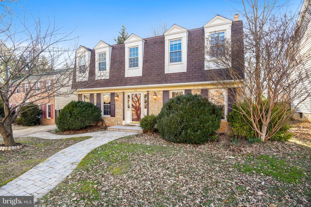 STUNNING four bedroom, two-and-a-half bathroom brick front colonial in the heart of Arlington - walking distance to silver/orange line metro and shops/dining at the NEW Ballston Quarter!  This lovely home features a huge lot, open kitchen, 2 gas burning fireplaces, and newer gleaming hardwood floors on the upper living level. Large deck, 2-car driveway, lots of street parking, and quiet neighborhood! The light-filled formal dining room easily fits a full-sized dining room table. The gourmet chefs kitchen, with space for a table, offers lots of cabinet storage and updated countertops. The living room, an expanded family room, with a bay window, and a powder room complete this level.The upper living level features FOUR generously size bedrooms, with oodles of closet space. The master suite easily fits a king bed, plus features a large walk-in closet and en suite bathroom with dual vanity. The lower living level is a perfect space for play & entertaining! Ceramic tile floors & built-in bookcases adorn the space. Access to a powder room, newer laundry machines, & a workshop completes this home. The fully fenced in backyard is the perfect space for summer entertaining!  Luxury + location - this home has it all!