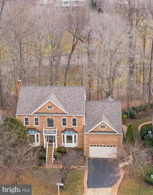 OPEN SUNDAY, 5/12, 1-3 PM * Stunning Golf Course Home in Lowes Island, backing to Trump National Golf Course & close to The Potomac River *  Truly one of a kind, you will love the spectacular golf course & wooded views * Versatile floor plan can be utilized many ways with potential for bedrooms on any level, plus full baths on all levels * Two separate entry doors from garage to lower or to main level * Two story main foyer, hardwood flooring throughout main level * Formal living room & dining room with bay windows, crown molding & chair rail * Custom main entry door & interior French doors with etched glass inlays *  Lovely family room inc. gas fireplace with floor to ceiling stone surround, mantle & ceiling fan * Large kitchen & gorgeous sunroom extension, includes wall of floor to ceiling, newer double casement windows, arch-top transoms and Andersen doors to outdoor deck * Gourmet kitchen includes granite countertops, beautiful copper tile backsplash, large center island with Jenn Air cooktop, full size double wall ovens, Bosch dishwasher & refrigerator with appliance panels * Beautiful copper undermount sink with upgraded faucet with pull-out sprayer & built in soap dispenser, casement windows above sink * Showcase your crystal in the two-sided glass door cabinets above the breakfast bar * Enormous walk-in pantry/closet in kitchen * Built in planning desk with cabinets * Main level includes full bathroom with floor to ceiling upgraded floor to ceiling tile in shower * Private entry door to main level bedroom or office with two large closets * 5 bedrooms on upper level, all with overhead ceiling fans * All bathrooms have been beautifully updated * Master bedroom includes vaulted ceiling, extra spacious walk-in closet * Luxurious master bath with Roman shower, oversized soaking tub, private water closet, raised double vanities with beautiful granite and Decora soft close cabinets, custom mirrors, built-in LED lighting * Laundry chute conveniently located on upper
