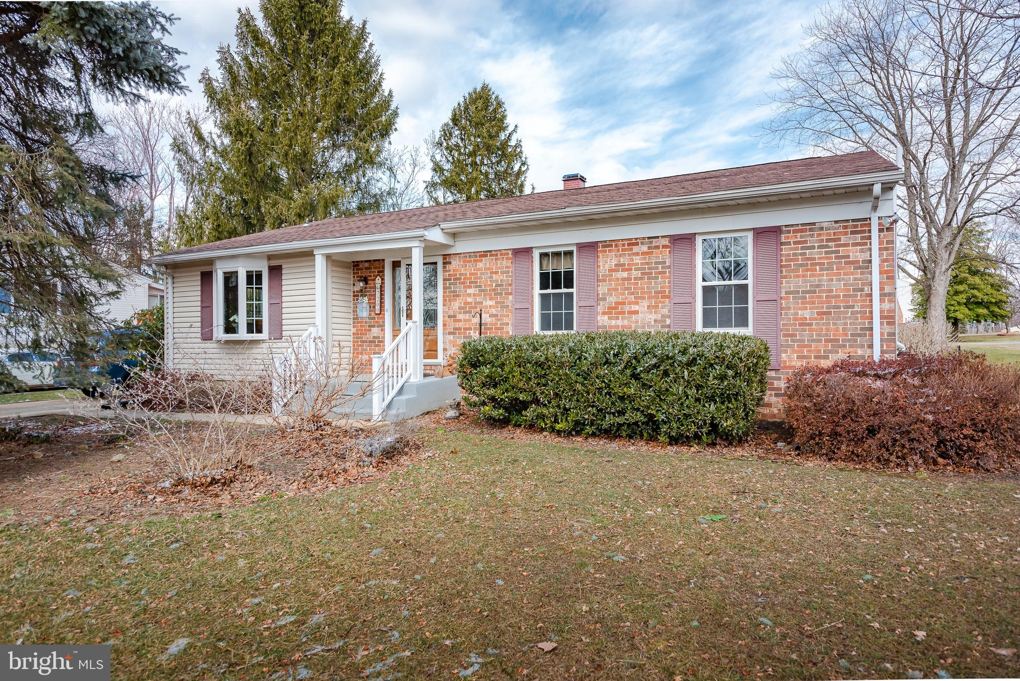 Beautifully upgraded Ranch-style home on large corner lot offers exceptional, move-in ready living spaces!  Easy to care for wood-look laminate floors span the main level living spaces including dining room with bright bay window, newly updated kitchen featuring quartz counters, stylish grey cabinetry, tile backsplash, farm sink and sunny breakfast nook off spacious living room overlooking concrete patio and flat, fenced back yard.  Comfy main level bedrooms include sizable Owner~s suite with double closet and newly remodeled attached full bath.  Complete with full, finished basement featuring an expansive Rec Room, full bathroom and plenty of space for storage with built in shelving! Conveniently located to shopping, dining and highways, this home is all you've been searching for!