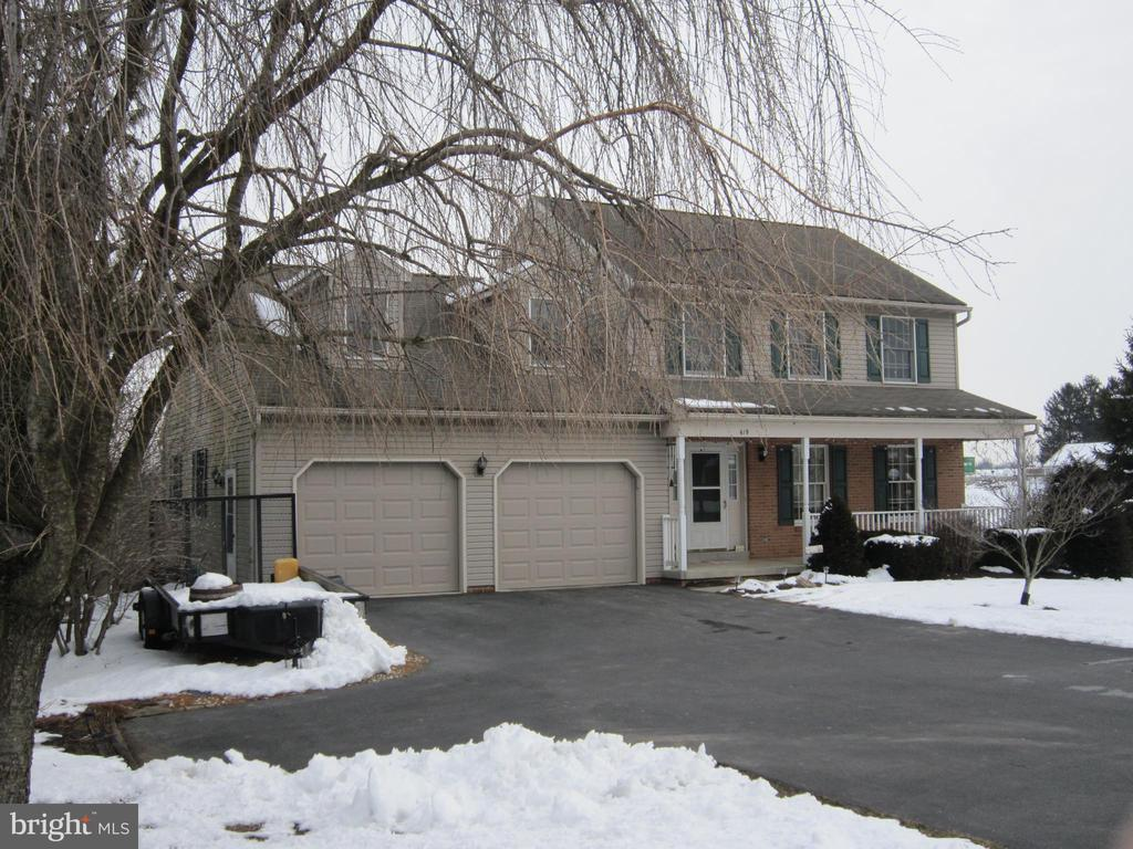 Country 2 story 3 bed w/ large 4 unfinished bed. Daylight basement with shop. Maintenance free with farm land. Boundary (must see!)