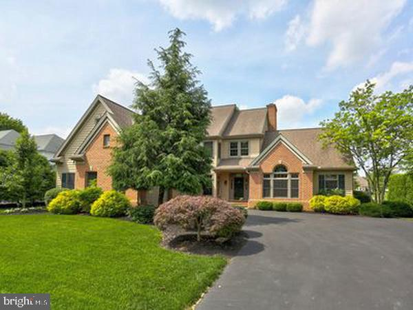 With a gorgeous view of the first fairway of Bent Creek Country Club, this Manheim Township Colonial is a paradise for entertainer's. Nestled on .35 acres of lush greens, bordering an authentic English garden, this custom built home features 3 bedrooms, 2.5 baths, and more than 3600 square feet. The 2-story family room with wood burning fireplace, built-in shelving offers stunning views of the golf course. This home is move-in ready and is the perfect place to celebrate the simplicities of life. The view is truly spectacular and is visible from numerous rooms throughout the home. The exterior ambience is serene and peaceful, especially with the stunning neighboring English garden. Two separate patios create an atmosphere that is ideal for dining alfresco or playing outdoors with pets. Additionally, the dramatic woodworking throughout the home is truly superb and makes for a timeless interior style.