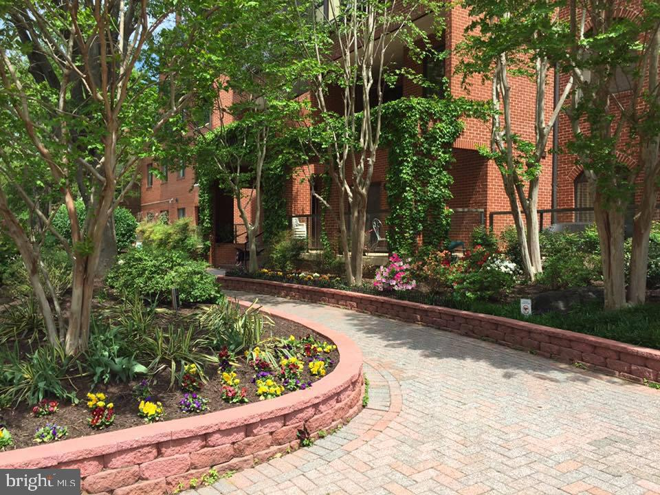 ESTATE SALE. 1/2 Block Ballston Metro. Rarely Available 2-Level Unit w/ Sunny Southern Exposure. Includes Balcony, w/d, 1-Assigned Garage Parking Space, Reasonable Condo Fee. Great Opportunity for Someone Who Wants to Customize. Your TLC and Personal Style Can Turn This Frog Into a Prince (or Princess)!