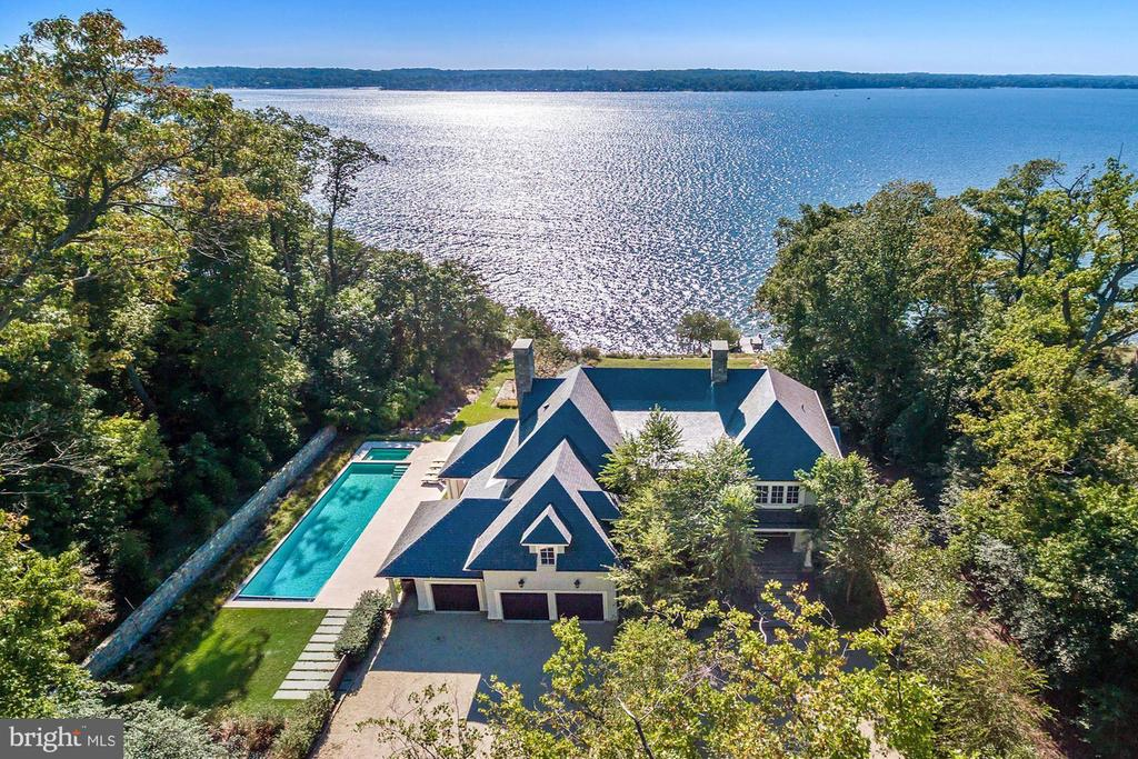 Built in 2014, 630 Magothy Road is a stunning waterfront property on the Magothy River representing the finest combination of amenities for buyers desiring a high-end, turn-key, luxury home. Situated on a 2.46 acre wooded private lot with sweeping views of the Magothy  and the southwest sky with its resplendent sunsets, this masterpiece 11,200 square foot plus Shingle Style house was designed by Vincent Greene Architects and built by Pyramid Builders, one of the region~s top builders of distinctive houses. With an open floor plan perfectly suited for todays living and entertaining needs, this magnificent property offers a main level with inviting entry hallway, generous living room, gourmet island kitchen with ample dining area adjoining the family room, loggia with radiant heat and Loewen sliding glass doors, two powder rooms, an upper level with five bedrooms, each with en suite bathrooms, including a superb master bedroom suite, an office and a partially-finished lower level with exercise room, potential sixth bedroom and expansive unfinished space for additional living. Finishes and amenities include random-width, walnut floors, high ceilings on all levels, three fireplaces, laundry rooms on the main and upper levels, a state-of-the-art, multi-zone, geothermal HVAC system, 3-car, oversize garage, extensive hardscaping, rear IPE porch overlooking the Magothy River with 200 feet of water frontage, heated pool with automatic cover and heated spa, a dock with boat lift, 25 kW generator that runs two thirds of the house, slate roof, expansive rear garden and lawn, irrigation system and outstanding finishes inside and out. Information on Gibson Island--A private island within one hour of Washington, D.C., and Baltimore; absolutely extraordinary setting - 1000 acres with seven miles of shoreline, two thirds of land undeveloped and owned by the Gibson Island Corporation, one third residential home sites,  no need to cross the Bay Bridge - located on Western Shore of Maryland, 43-acre spring fed fresh water lake, enormous  privacy and security--entry gatehouse staffed 24+Hours and Gibson Island Police Force  (GIPD,)Gibson Island Corporation Service Department for homeowners offering yard maintenance and landscaping and other services, full service yacht yard, 20 minute drive to BWI, airport and train station, private country club (membership by invitation) offering yachting, fine dining year-round, tennis, award-winning Charles Blair Macdonald designed 9-hole golf course, swimming, croquet, skeet shooting, and more , private tours by appointment.  (C) Gibson Island Corporation, all rights reserved.Please view our videos of this stupendous property.