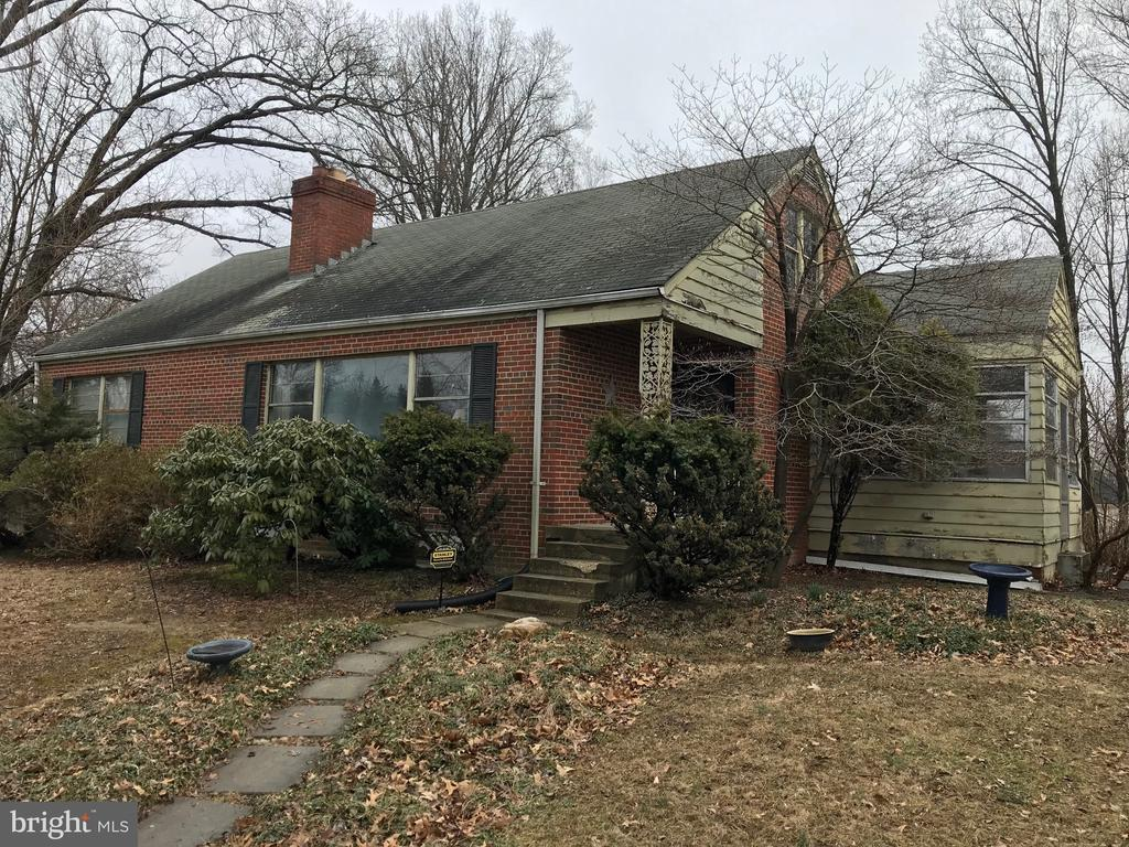 Solid Built Brick Home! Hardwoods. 2 Fireplaces. Sits At Top Of Hill On Large Lot. Restful Views. Plenty Of Windows. Spacious Attic With Large Windows. Lower Level With Windows And Natural Light. Sun Room. Plenty of Parking. Great Location. Needs Work - But The Best Short Sale Opportunity You Will Ever Find!