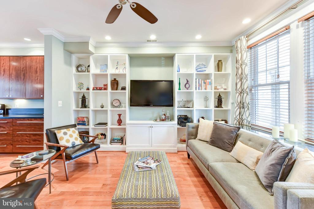 Contemporary Colonial Home in H Street/Atlas District | 3 Bed | 2.5 Bath | 1,900 Sf | 1,260 Lot Sf | Expansive Private Patio | Home: Recessed Lighting Lots of Natural Light, Separate Living & Dining Spaces, Custom Built-in Shelves in Living Room, Plenty of Storage Throughout, Hardwood Flooring, Closets w/ Built-ins, Powder Room, Front Porch & Expansive Private Patio w/ Cherry Blossom Tree, Stacked Laundry | Kitchen: Kitchen Island w/ Granite Counter Top & Seating for 4 | Double Basin Sink & Prep Station, KraftMaid Custom Cabinetry, Under Cabinet Lighting, Stainless Steel Appliances, Full Size Dishwasher, Wine Fridge, Gas Range, Wet Bar, Pantry and Extensive Storage | Baths: Vanities w/ Storage, Mirrored Medicine Cabinet, Ceramic Tile Flooring, Vessel Sinks, Kohler Toilet, Dual-Headed Shower with Wall Jets | Basement: Full Kitchen w/ Gas Range, Full-Size Dishwasher, Heated Tile Flooring Full Bath w/ Jet Spa Tub, Vanity w/ Storage, Walk Out to Backyard