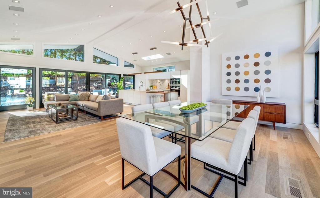 BRAND NEW RENOVATION! OPEN HOUSE SUNDAY (3/24) 2-4PM! A fabulous Forest Hills renovation by Coba has brought this late 1950s home a new life in the 21st century!Two luxurious levels include 5 Bedrooms,4.5 Bathrooms, and approx 4,100 SF of thoughtfully re-designed living space with only the highest quality finishes and detail. Open floor plan includes a grand living space with 12.5-ft cathedral ceiling and walls of windows including sliding glass doors opening to a private rear garden allowing for seamless indoor-outdoor entertaining. Must see!