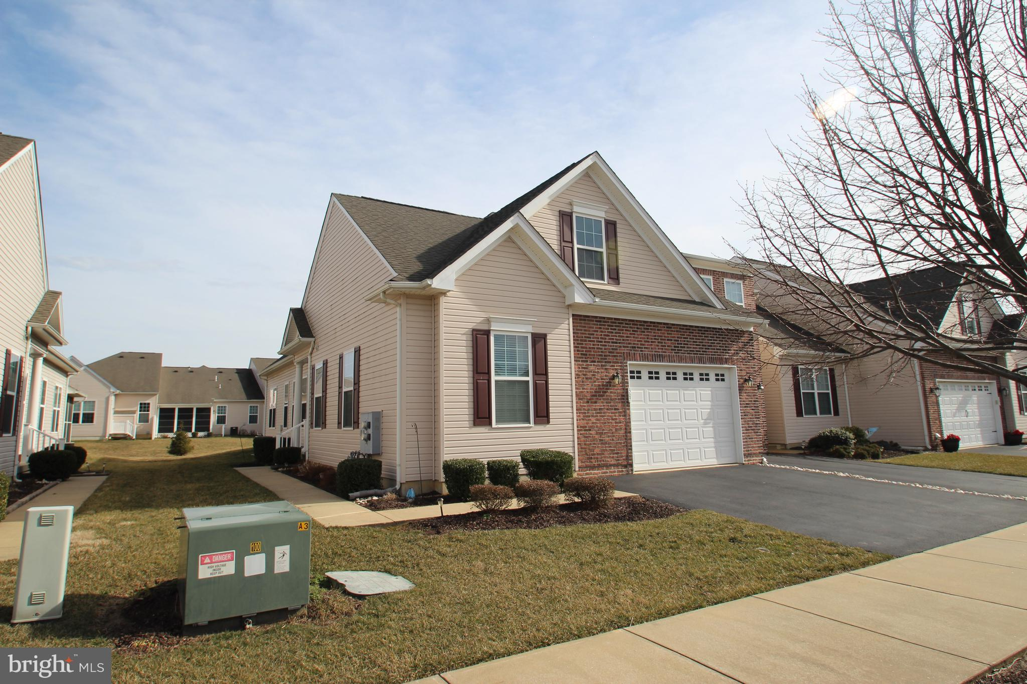 End unit home in wonderful 55+ neighborhood of Spring Arbor!  This floor plan offers a spacious layout with formal living and dining rooms, large kitchen with recessed lights, 42' maple cabinets and tile back splash and a pantry.  Enjoy the brick patio off of the sliding glass door from the dining room  The master bedroom features a nice sized adjoining sitting area, large walk-in closet and full bath with 5' shower, and tile floor. The second bedroom is on the opposite side of the home and is extra large due to the option for an oversized one car garage rather than a 2 car garage.  Walking distance to the very active community clubhouse featuring outdoor pool, social rooms and lounges, exercise facility, kitchen, putting green, bocce ball court, organized activities, etc.  Easy to show, make your appointment today!