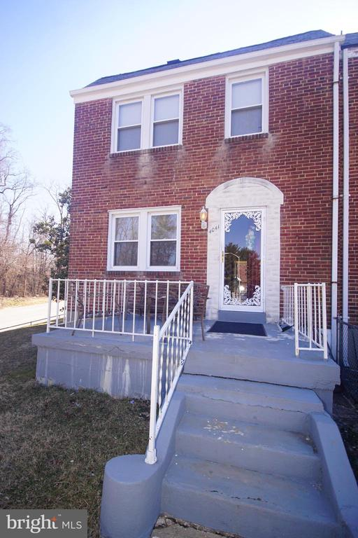 Don't miss out on this lovely, 3br 1.5ba well maintained, Brick front, End of Group town house on the corner lot in the East Arlington neighborhood in Baltimore City. This home is move ready. It features central a/c, washer & dryer, recently purchased hot water heater, upgraded electrical panel, a fenced front & back yard, magnolia trees, alarm system and so much more to love. Put your finishing touches on this one and create instant equity! Own this home for less than you rent! Schedule your showing NOW! Priced to sell.  10K Price Adjustment. Make this your own.