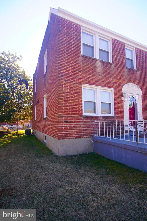 Don't miss out on this lovely, 3br 1.5ba well maintained, Brick front, End of Group town house on the corner lot in the East Arlington neighborhood in Baltimore City. This home is move ready. It features central a/c, washer & dryer, recently purchased hot water heater, upgraded electrical panel, a fenced front & back yard, magnolia trees, alarm system and so much more to love. Put your finishing touches on this one and create instant equity! Own this home for less than you rent! Schedule your showing NOW! Priced to sell.  20K Price Adjustment. Make this your own.
