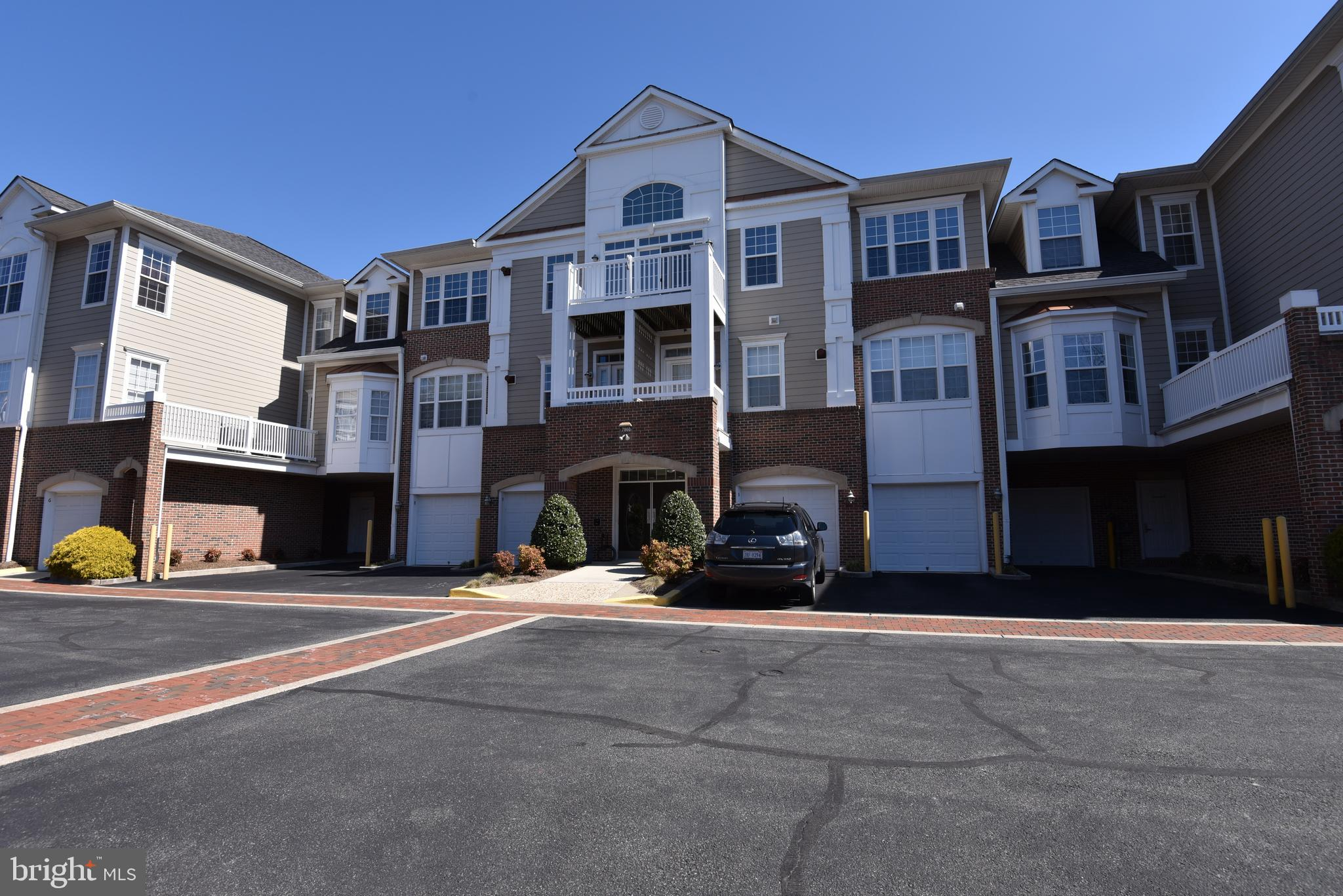 """Wonderful Open Floor Plan Condo in an Active Adult Community (55+). HiddenBrooke is a Carefree Living and Secure Community near all Major Commuter Routes. Convenient Location: 9 Minutes to Springfield Metro, Springfield Town Center, Close to Fort Belvoir. Many Upgrades Throughout the Entire Unit. Upgraded Gourmet Chef~s Kitchen with Granite Counters, Stainless Steel Appliances, and Plenty of Cabinet and Counter Space. Beautiful Wood Floors Throughout. New Air Conditioner and Water Heater. Spacious Master Bedroom Suite with Spa Worthy Bath, and Two Closets. Relax by the Cozy Fireplace in your Large Living Room.  Within this Open Floor Plan, there is a Separate Dining Room. Private Balcony Overlooking Treed Area for Outdoor Relaxing and Bird Watching. The """"Bistro"""" is Located Down the Street Where the Exercise Room, Library, Club Room, and Kitchen ~ A Perfect Entertaining Venue.  Just Outside the Bistro is an Outdoor Patio with Dining Area, Community Grill/Outdoor Kitchen. WELCOME HOME!"""