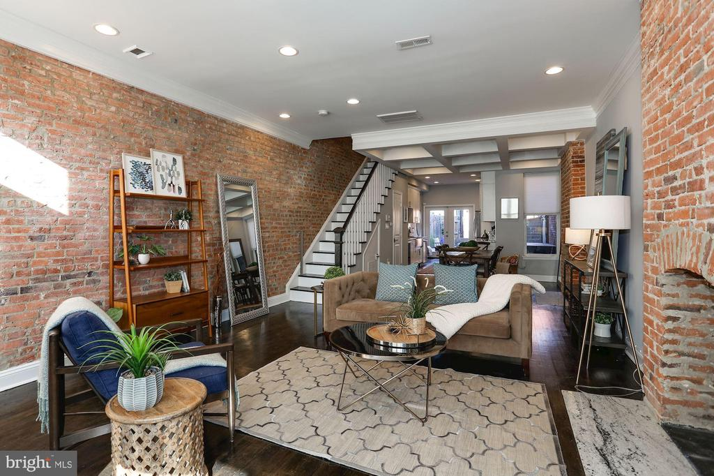 **Cancelled Open House** Amazing 3BR/2.5BA home renovated to perfection in the heart of H Street. Offering gorgeous exposed brick fireplaces, coffered dining room ceiling, gourmet kitchen, private patio & PKG. Owner's suite boasts exposed brick and loft ceiling. Refinished HW floors & renovated baths throughout complete this traditional gem. Rear parking with garage door and large entertaining space. Smart Home features include NEST thermostat & cameras, app-enabled lighting & built-in Sonos speakers. Enjoy quick access to H Street, Eastern Market, Whole Foods, Union Market, restaurants, coffee shops, Metro and so much more!