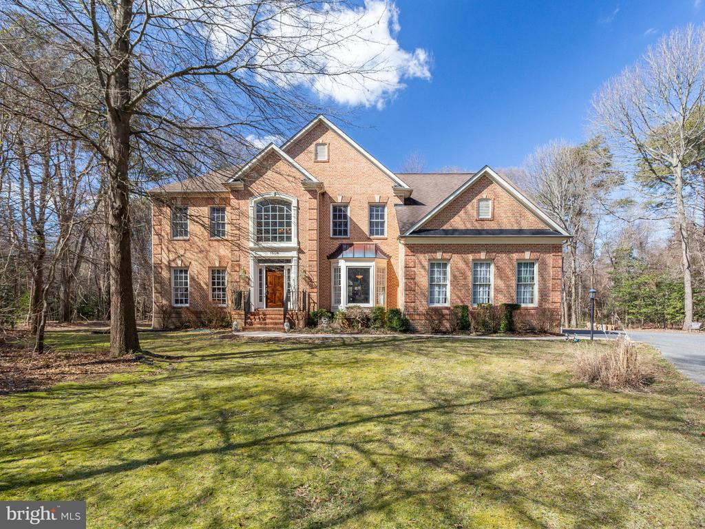 Incredible 3-Sided Brick, 5 Bedroom, 4.5 Bath Colonial! Fabulous Kitchen with Center Island and Light and Bright Breakfast Room.Front and Back Staircase. Family Room with Vaulted Ceiling and Stacked Stone Fireplace with Pellet Stove. Luxury Master Suite with Spa Bath.Bedroom with full bath. Jack and Jill Bath.Lower Level Family Room with Wet Bar,Theater Room,Bedroom and Full Bath, Large Deck! Broadneck School District.
