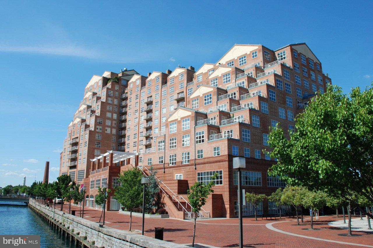 Spectacular 2 bed / 2 bath condominium in Scarlett Place.  Almost 2000 sq ft of living space!! Remodeled with beautiful finishes that include hardwood flooring / granite counter tops  and stainless appliances.  Open and large main living space, huge kitchen and a balcony with harbor views.  Popular Inner Harbor / Harbor East location close to shopping / dining and entertainment!!  1 deeded parking space included.