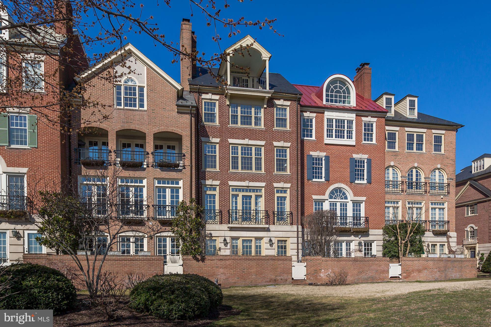 This spectacular waterfront townhouse is perfectly located in historic Old Town, Alexandria, named one of the top five best small towns in America.  With expansive Potomac River views from all five levels, this home is an oasis of calm and serenity, just three walkable blocks south of vibrant King Street. Enjoy watching sunrise over the river, boating activity during the day, and the festive lights of National Harbor in the evening.  Situated in the meticulously manicured private neighborhood of Harborside, this home has been completely updated, remodeled, and renovated, with close attention to quality finishes. Featuring an elevator that services all five floors, it is not only elegant and classic, but comfortable and practical.  Completing the appeal of waterfront living, a 40~boat slip in the adjoining marina is part of this offering.On the first level, the two-car garage is thoughtfully heated, while the sophisticated marble foyer sets the tone for the rest of the house. The entry level also features a welcoming Family Room with a gas fireplace.  French doors open to the walled brick patio from which the wooden gate provides direct access to the waterfront pathway.  The patio, bordered by gardens just readied for spring, is a perfect spot for al fresco dining and entertaining. A Powder Room and coat closet are also conveniently located on the ground level.  The staircase with landing leads to the second floor, where morning sunlight streams through the Living Room~s four glass-paned doors, reflecting off the stunning water views. This spacious room has crown moulding, wood floors, and a gas fireplace with marble surround.  Conducive to entertaining, the Living Room opens to the Dining area and gourmet chef's Kitchen,  an inviting space for both cooking and conversation.  The custom Kitchen features a large island, Sub-Zero French door refrigerator/freezer and wine storage unit, Wolf gas cooktop, electric convection oven and microwave, and Miele dishwasher.  The 