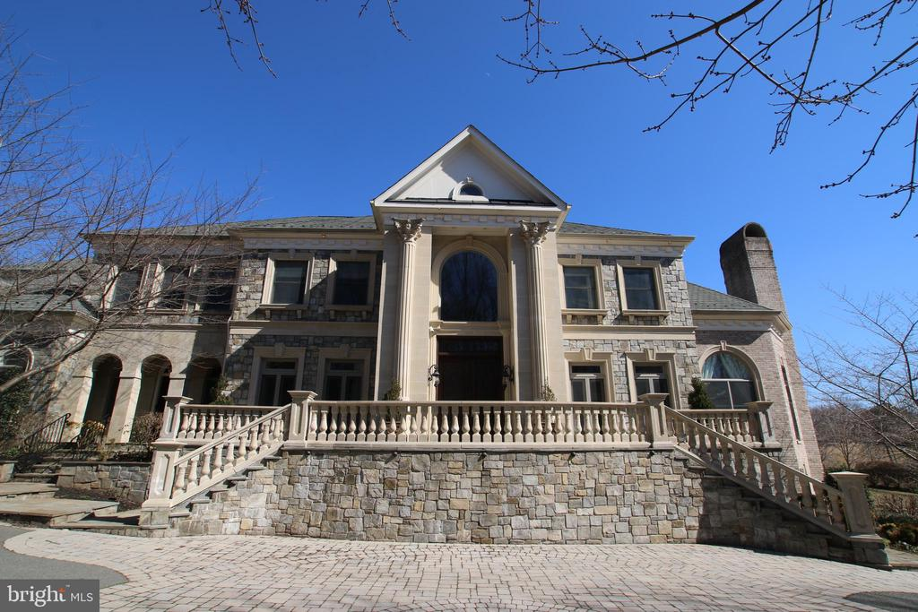 This extraordinary mansion sits on two beautiful acres in the middle of Great Falls, Virginia.  With a beautiful exterior made of stone, brick and pre-cast, this mansion is one of the most elegant homes in Northern Virginia.  In addition, the opulent interior finishing by an award winning designer makes this residence stunning, yet comfortable and inviting.  Entrance is secured by custom iron gate and heated driveway is covered by brick pavers.  The backyard oasis features a pool with fountain, hot tub, cabana with fireplace, barbeque area, fire pit, spacious patio and huge playground.  Some of the interior features are 11 foot ceilings on main level, 10 foot ceilings in basement 9 foot ceilings on upper level, Brazilian hardwood cherry floors, detailed trimmings, six remote controlled gas fireplaces, elevator, chandeliers throughout, gourmet kitchen and chef's kitchen, Mahogany covered library, home theater, and too much to list.  Stunning custom paint work is seen in every corner, from the inside of the tray ceilings to all walls and to the kids' bedrooms where the scene transports you to a magical place with artistic custom murals.  This unique estate was put together to give privacy, enjoyment and functionality to every member of the residence.   With the separate guest quarters, the kids' Au Pair will have her own privacy and the grandparents can have full functioning as well.  Looking for quality, functionality, comfortable living with craftmanship and attention to detail in design and finish?  We have the answer for you at 529 Springvale Rd., ready for you (sold AS-IS)