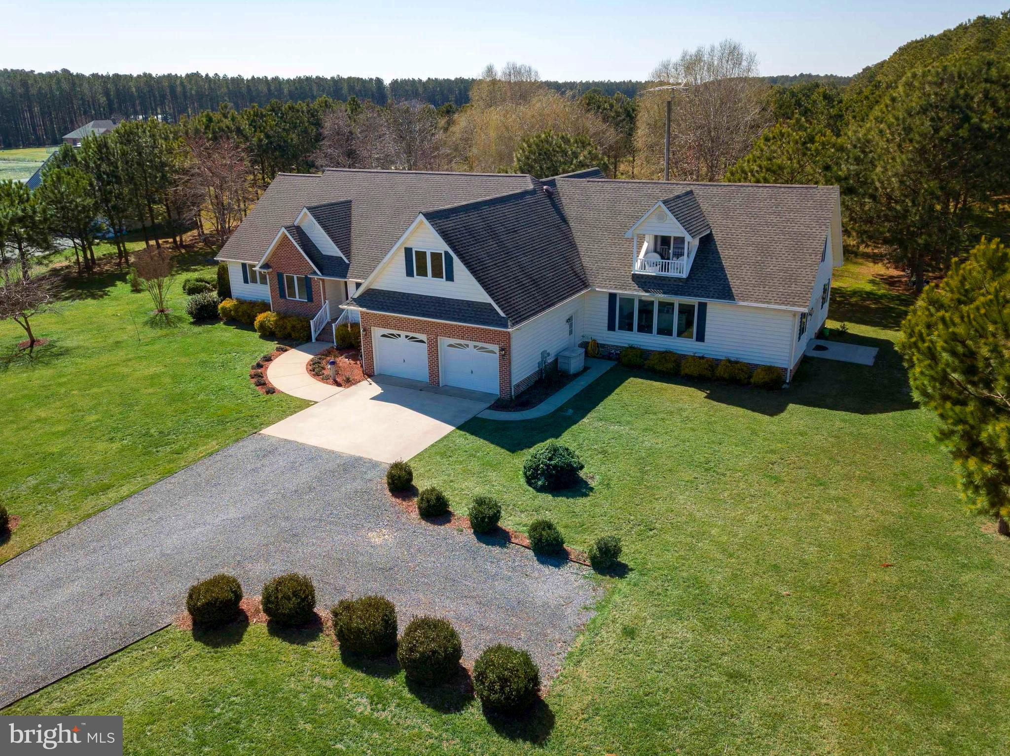 Arguably one of the nicest Waterview Homes on the market!  3/4BR, 2.5BA, Kitchen w/Granite tops and Island, Office, Den, Living Room w/gas FP, Second Floor Balcony, 2 Car Garage, attached shop, and large Cedar Deck on the back all on 1.85 acres.  Tons of Storage.  The amenities are truly too numerous to mention them all.  Come check it out, you won't be disappointed!