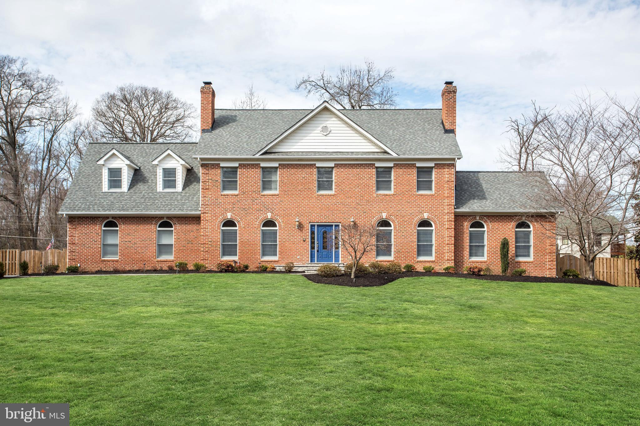 Stately custom-built Georgian brick only a block from the Potomac River Nearly one acre fenced level lot in the desirable Mason Neck waterfront community of Gunston Manor. Spectacular sweeping river views, private sandy beach, boat dock and rec facilities are just a few of the amenities available. Among the numerous interior updates are the stylish kitchen featuring Carrara marble counters and glass/ marble back splash, newer appliances, updated lighting and fixtures. The main level of this home home features formal living and dining rooms; family room; hardwood floors; new carpet. The second level offers a luxury master suite with 3-sided fireplace and spa style remodeled bath and 3 additional bedrooms. There are 4 fireplaces and a fully finished basement with walk -up stairs.New 16KW Generac generator (2019) and new roof (2016) too.Your own private retreat - only 20 miles to DC . Bring your boat!   *HOA Fees optional.  Allows access to beach, dock, boat slips, community center, and basketball court.*