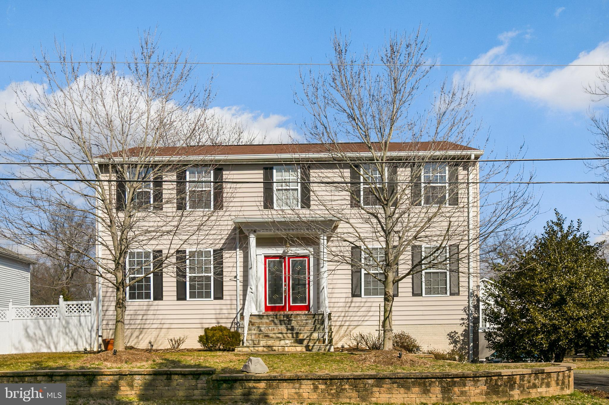 This stately colonial has had many recent updates! New wood floors installed on 2nd floor and basement ($14k), new water heater ($800), fresh paint through-out ($5k), and a new built-in microwave ($300).  The HVAC was replaced in 2015 ($12k) and the kitchen was fully renovated in 2014 ($35k).  With an expanded driveway and 2 car garage entrance on Pole Road, the house actually fronts Carlwood Road, a quiet, dead end street with ample guest parking. Extensive, mature landscaping for seasonal displays of color! Work shop is a tinkerer's dream!  2 bus stops within one block in either direction!  Easy access to Kingstowne, Fort Belvoir and Huntington Metro.  Express bus lanes coming to Rte. 1 soon, as well as the Embark Richmond Highway revitalization plan - Get in now!