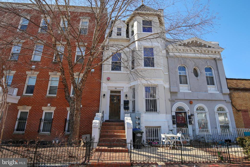 Zoned MU-4. Perfect for owner occupant OR savvy investor.  Where else in DC can you live in a renovated 3 level, 2BR/2.5BA with fireplace and fenced garden, in a historic row house, in the heart of the H ST corridor while your tenants pay 4,350 of your mortgage? OR live in the in law suite and rake in 5,850/mo in rent. Or turn the whole building commercial by rewarding the amazing existing tenants and double the income. Unit 1=4 level, 2BR/2.5BA on top 3 floors, fireplace, fenced front yard + large in law suite studio bsmt w/sep kitchenette and laundry, fireplace and separate entrance.  Unit 2= 3 level, 1+den+ 2 fireplaces+ balcony + patio +fenced rear yard + parking(yard pull in) + large fin LL (BR/in law suite)w/sep kitchenette and own entrance from rear.  Building completely renovated in 2008, updated again 2015. Tenants pay all utilities including water, owner pays house meter for hallway-electric only. Legal parking space possible. AMAZING/UNIQUE opportunity to enjoy all that H St corridor offers.