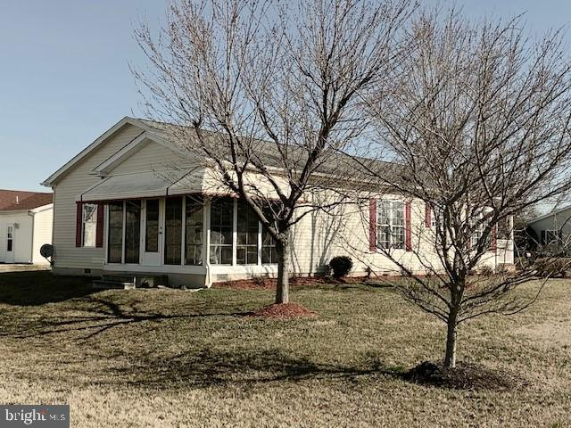 This Lovely home has 2 bedrooms and  2 full baths, and sits on the end of a lane next to our walking path. It offers an oversize garage, a gorgeous 3 season room, Plus a Front porch! The kitchen has a gas range, all appliances, kitchen also has a pantry.  Plus a breakfast room to enjoy your morning coffee. A large combo Living room  / dinning room  combo for all your entertaining needs. The 3 season room sits off the living / dinning area with a private view of the walking path. The large garage offers a workbench and shelving for storage.Price was just reduce because window in kitchen is New and if very windy it has a slight whistle. This home is Move in ready and waiting for !