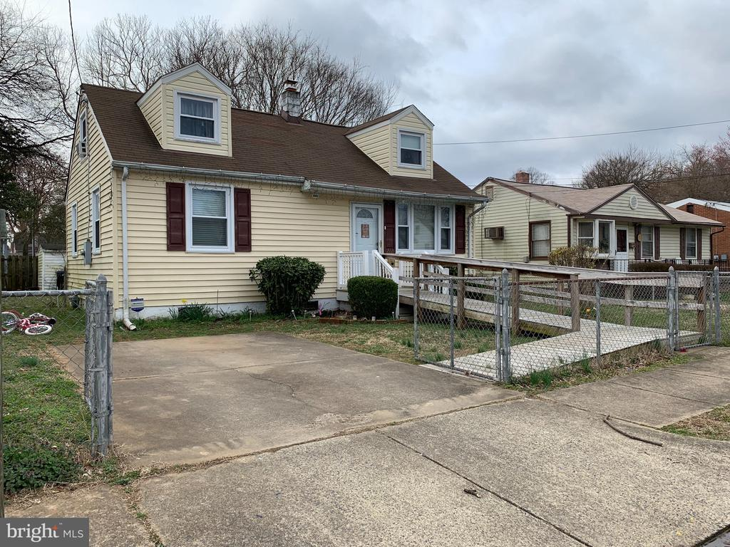 4 bedroom 1 bath Cape Cod with handicap ramp. Fenced yard. Shed. Real wood floors.