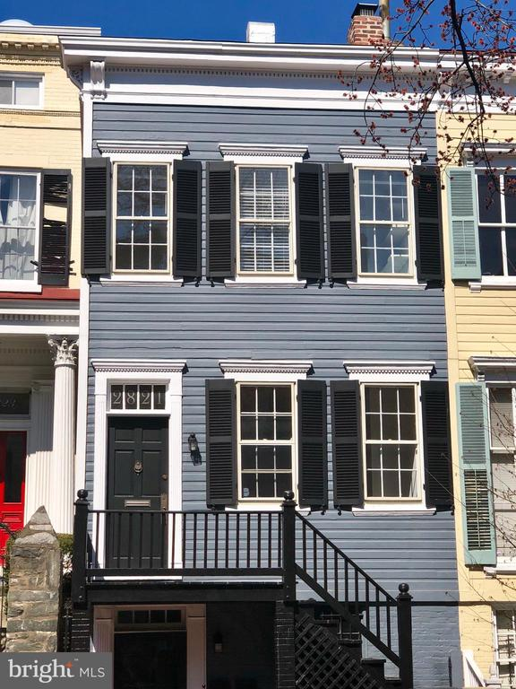 Bring your buyers to this sunny South facing row house in Prime Georgetown with perfect backyard entertainment space with multiple levels and brick patio. Rare Main Level Kitchen; High Ceilings; 3 bedrooms and 2 full baths on second level. Finished lower level. AS-IS. Needs Work.  Lease Considered for 24+ month term.