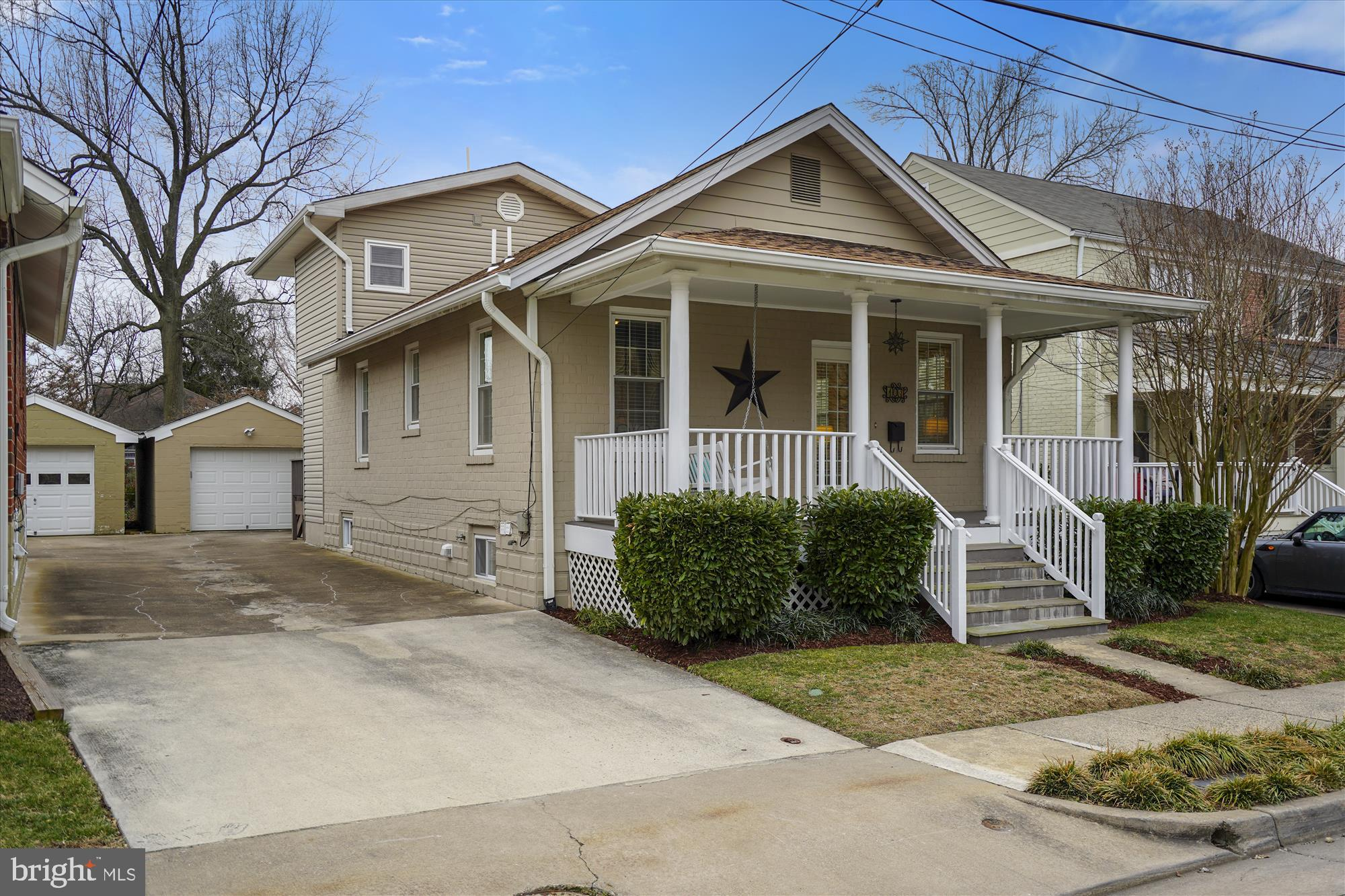 Located 1 block off The Avenue in the heart of Del Ray, this beautifully remodeled, sun-filled 3BR/3BA bungalow has a 2-story rear addition and a REAL 1-car garage. Spacious Living Room with wall of windows, plus open Dining Room and Kitchen with French door to deck. The main level also 2 bedrooms and a full bath. On the upper level is a king-size MBR suite with walk-in closet and MBA. The finished lower level has a large, bright Rec Room, full bath, laundry, and utility room. Gleaming hardwoods, built-ins, recessed lighting, and amazing storage in the HUGE walk-in attic. Enjoy spring on the front porch swing and in the landscaped backyard with patio and deck. A gem that's a true 10!