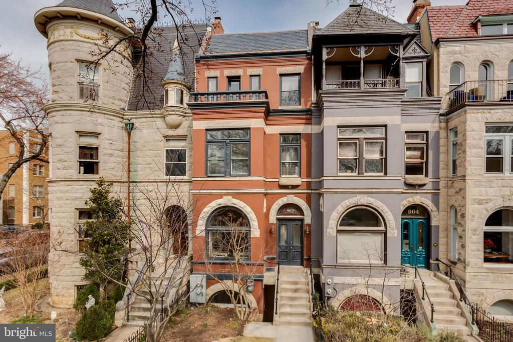 Historic Romanesque Revival mansion originally built in 1896 - restored and renovated in 2018 - 2019. Unobstructed views of the Capitol and Washington DC from rooftop terrace. Modern, architect designed interior with historical features preserved, this 4,066 square foot home has 5-6 bedrooms and 4 1/2 baths. Large kitchen with custom cabinetry, quartz counters, integrated Sub-Zero and Wolf appliances, and lots of daylight from a floor-to-ceiling glass enclosure leading to rear balcony and patio area. Master suite includes walk-in closet and luxurious bath with dual vanities and freestanding soaking tub. Finished lower level with large great room and custom wet bar. Restored original hardwood flooring and transom windows. One block to Lincoln Park and steps to Barrack's Row, Eastern Market, Eastern Market Metro, the US Capitol, and Supreme Court. For more information, visit 902eastcapitol.com.
