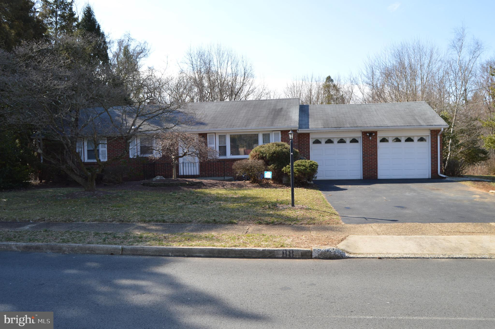 """This well built custom brick ranch is ideally located in the popular """"Washington Square"""" community in Yardville. It sits on a .38 acre lot that backs to woods owned by Hamilton Twp. There is an over-sized two car attached garage, a 10 x 14' storage shed, paver patio and a 10 x 17' car tent that is included. The interior includes a large living room, spacious eat-in kitchen, 3 bedrooms and a ceramic tile bathroom. The third bedroom with a closet is presently used as a den. There is also a full unfinished basement for extra storage and the opportunity to finish for additional living space. Some of the many features include: hardwood floors, a sun setter retractable awning over the patio, thermopane replacement windows, bay window in the 3rd bedroom/den, built in microwave and pantry closet, alarm system and all appliances plus a one year home warranty for added peace of mind is included."""