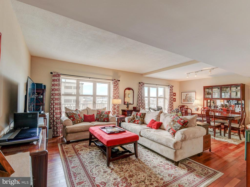 Spacious and bright 2 bed / 2 bath condominium in Scarlett Place.  Almost 1500 sq ft!  Upgraded kitchen with stainless appliances / open main living space and large balcony.  Luxury condo living with amenities that include secured parking / front desk staff / pool / fitness center and more.  All in an incredible Inner Harbor / Harbor East location that is walking distance to shopping / restaurants and entertainment!!