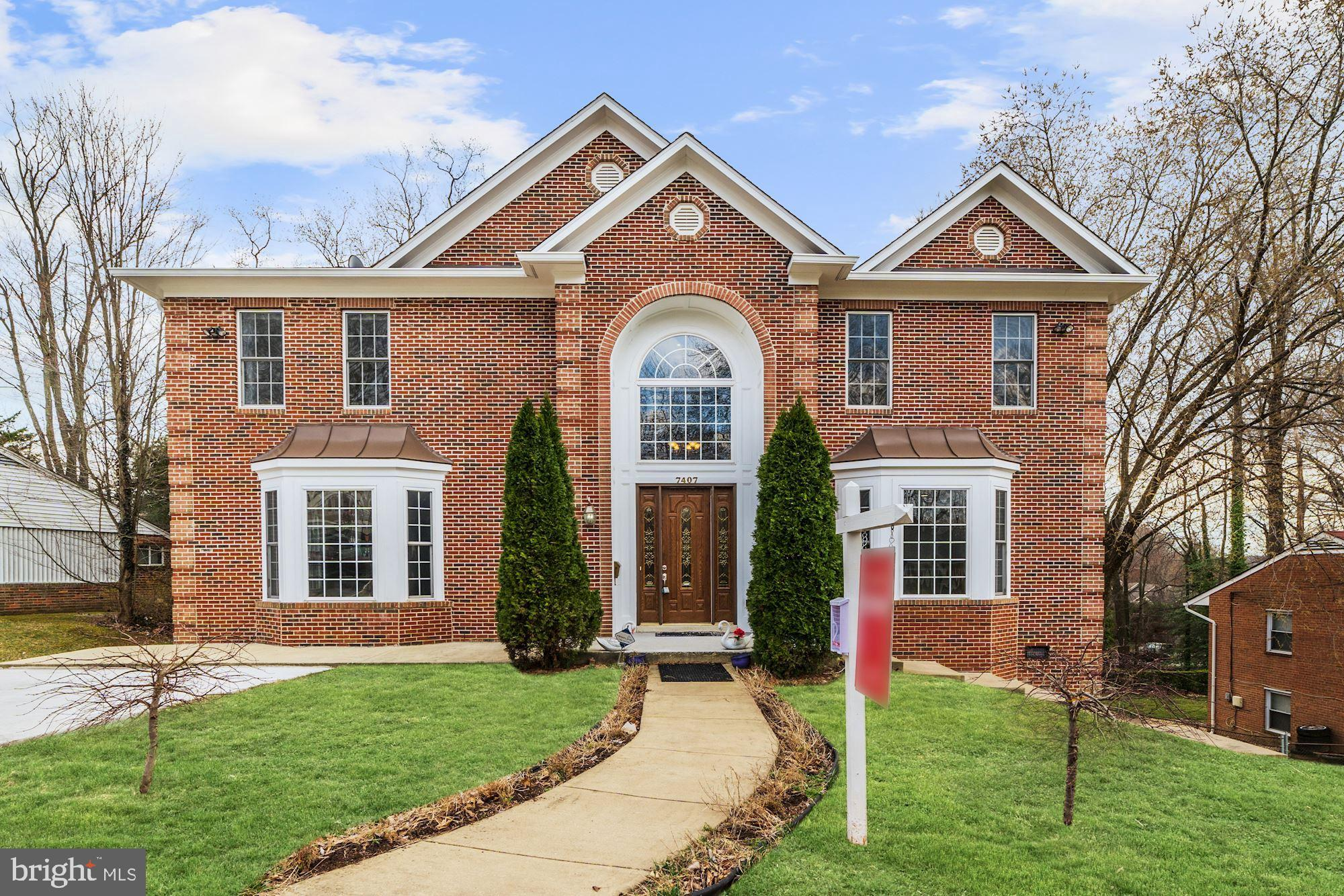 This elegant and beautiful brick front Colonial home is located in the Monticello Forest subdivision of Springfield. Well maintained, spacious,  multi-generational/move-in ready home has everything you are looking for! Grand entryway foyer with Palladian window, ceramic tile, and pendant chandelier. Superior craftsmanship and attention to detail are evident. Stunning curved doorways, crown molding, chair rail, and wainscotting.Gleaming hardwoods, large kitchen with double french doors to deck overlooking the private yard. 1 Main level BR + 1 Full BA, 6 Upper-Level BR's and 2 Full BA's.The finished Lower-Level has a full-size kitchen, LR/DR area, 1 Bedroom, 1 Full Bathroom, separate entrance. Close to Springfield Town Center, commuter lots, and much more. This is a  MUST SEE HOME!!!