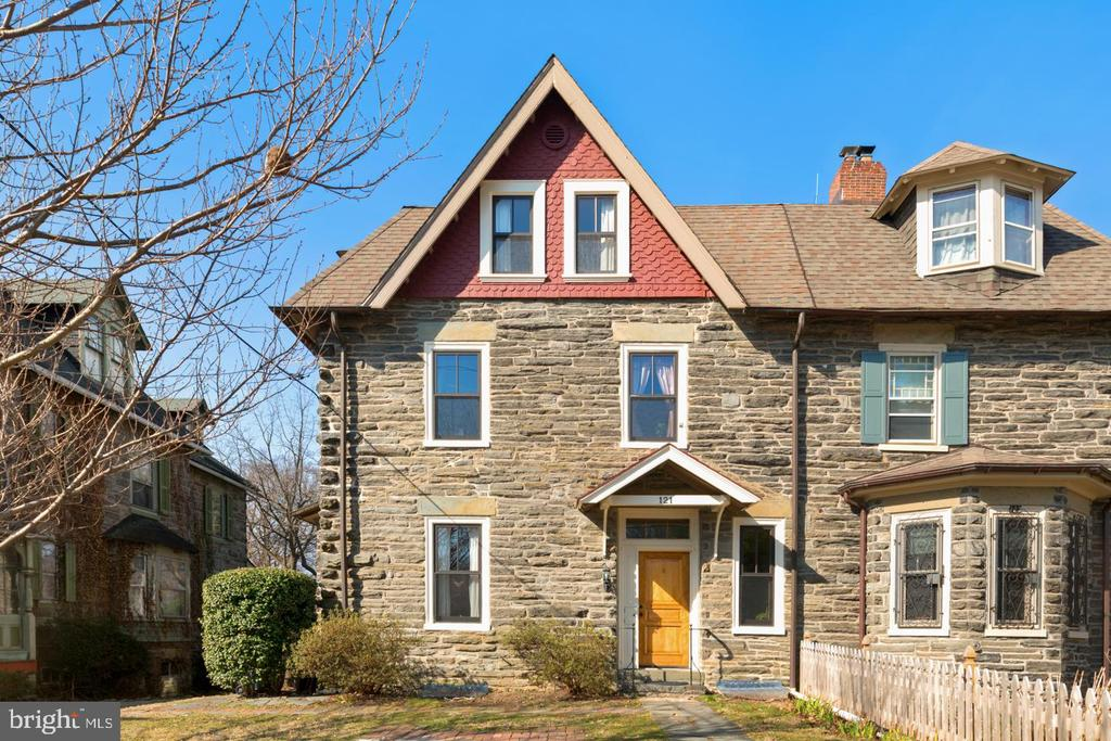 Amazing Value in the heart of Chestnut Hill!  Incredible Stone Twin!  Work was hand done meticulously by a former owner.  The level of quality really must be seen to be appreciated fully.  Beautiful hardwood floors thruout the entire house have incredible inlay detail around the perimeter.  It~s just amazing.  The living room has incredible light and an amazing fireplace with an built in wood stove.  The kitchen features soap-stone counters, a new refrigerator, and a built in farmers sink. Also on the first floor is a formal dining room which leads to a back deck overlooking the yard.  There is also a powder room on this floor. The 2nd floor features 2 bedrooms, along with a large dressing room off the master.  Master bath has tumbled marble tile thruout with an impressive open shower.  The 3rd floor has 3 additional bedrooms and a classic victorian style bathroom.  The basement is partially finished and includes a great mud room/storage area leading to the yard.  Close to everything Chestnut Hill, steps from the Chestnut Hill East station, Germantown Ave shopping and restaurants are just blocks away. Truly a spectacular home.