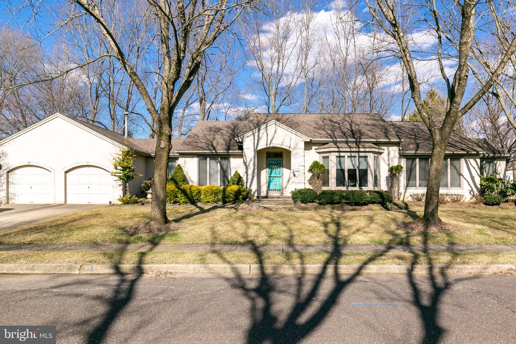 Welcome to Laurel Knoll East a premier location in Mount Laurel.  A three bedroom, two full bath sprawling rancher is a rare find.  This open floor plan provides plenty of natural light..  A large foyer looks into the family room with a gas fireplace with vaulted ceiling. A large eat in kitchen with granite counter tops, tile floor, stainless appliances and tile back splash.  A four season room sits off the kitchen giving you extra living space and a wonderful place to enjoy your morning coffee in the private backyard.  A large formal living room and formal dining room are all visible through out the open concept.  Three private bedrooms are down the hallway.  A main bath with double vanity, and tub/shower combination with tile flooring.  The master suite has a large walk in closet, full bath with a large walk in shower that has been updated.  An oversized two car garage with additional room for storage.  Other features include a two car garage, two zone heating and air conditioning, Conveniently located near shopping, major highways, Mount Laurel's award winning school system, and more.