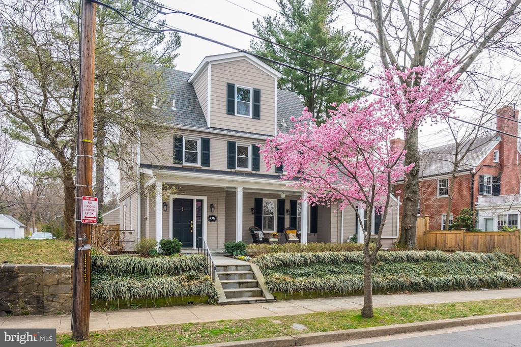 Masterfully renovated. Stunning 4 level 4BR/4.5BA AU Park Colonial. Inviting front porch and bright, open, expansive floor plan. 3400 SF. Gracious LR with frpl., all white chef's eat-in kitchen w/island & bkfst bar, adjacent to wonderful, sun-filled family room. Lovely formal dining room. Private Master Bedroom w/luxurious ensuite bath.  Lower level guest suite and recreation room with separate entry, lovely patio, garden & fenced level backyard, Oversized 1 car garage. Minutes to Friendship Hts, Tenley, Metro, bus, Whole Foods, Mass. Ave. shops & eateries.