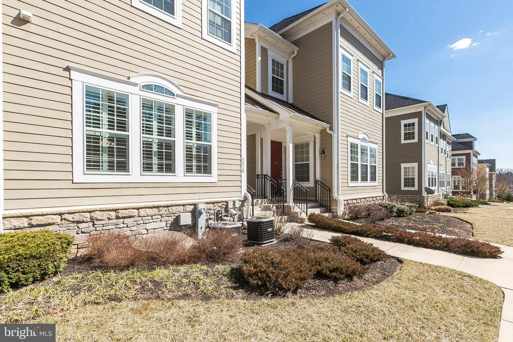 Pristine 3 BR, 2.5 BA townhouse with 2 car garage in convenient Woodbrook. Gourmet kitchen, wood floors, plantation shutters, gas fireplace, master suite with dual sink vanity, upper level laundry, and finished lower level. Exterior is HardiPlank and stone.