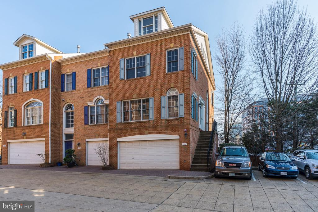 JUST LISTED! OPEN SUN 1-4PM! Spacious end unit TH in trendy and uber-convenient Ballston Crossing. Main lvl has 9' ceilings w/ large open Living/Dining room, Kit w/ breakfast area, entryway w/ powder rm. 3BR up, each with en suite Bath including luxe Owner suite with sep Tub/Shower & large walk-in closet. LL fam rm & walkout to back patio, 2-car garage! Easy access to all of VA via 66 & Glebe Rd, minutes from Georgetown & downtown Washington, 5 block walk to METRO, countless shopping & dining options of Ballston!