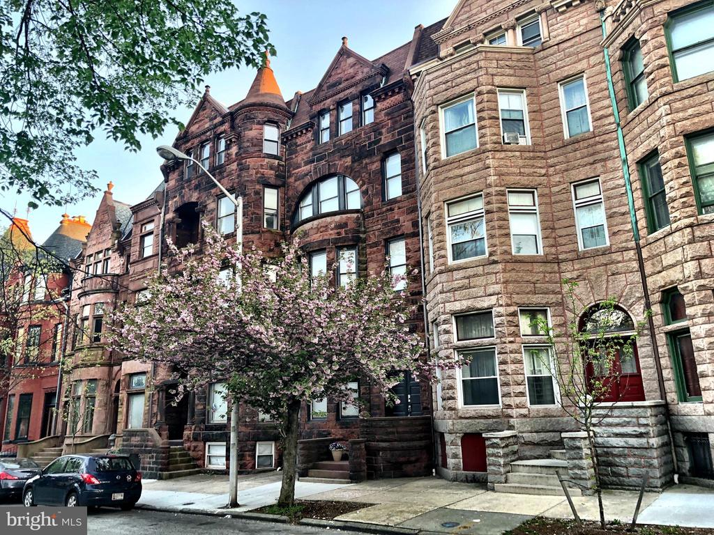 This gorgeous brownstone located in historic Bolton Hill is brimming with quintessential charm! Completely renovated & still full of historical integrity, this grand home offers nearly 7,000 square feet of updated living space, including 5 bedrooms & 5.5 bathrooms. Explore multiple master suites, an enormous chef's kitchen, finished basement & multiple living spaces complete with a wet bar. Enjoy crisp spring nights on the large rooftop deck & spacious patio. And, don't miss the 2-car garage! Plus, there are 3 years remaining of the CHAP credit. This home is a turnkey masterpiece & a truly rare find. There's nothing to do but move in!