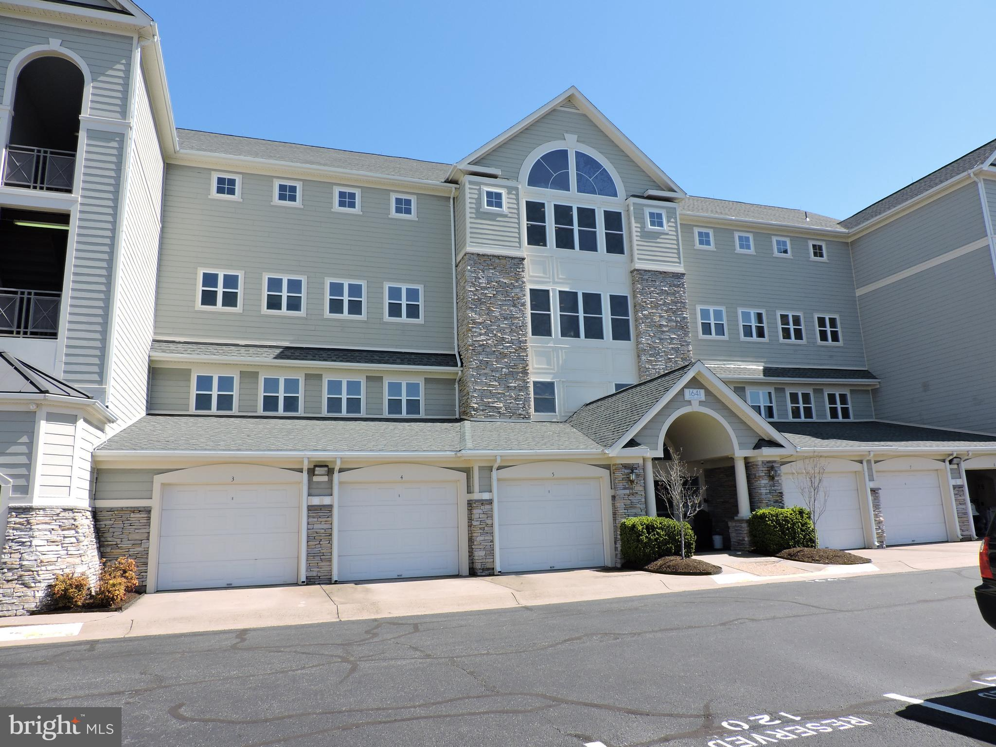 Don't miss out on this sought after condo.  Gated community with all the amenities. VRE commuters this is where you need to be. This unit includes a garage and storage unit- one of the few in the community. Bright open living space within river view. Spacious bedrooms and the master bathe offers a large soaker tub with separate shower anddouble sinks. Huge walk in closet. Gorgeous new wood floors in the living area and new carpets in the bedrooms. The kitchen features stainless appliances, granite counters and custom backslash.