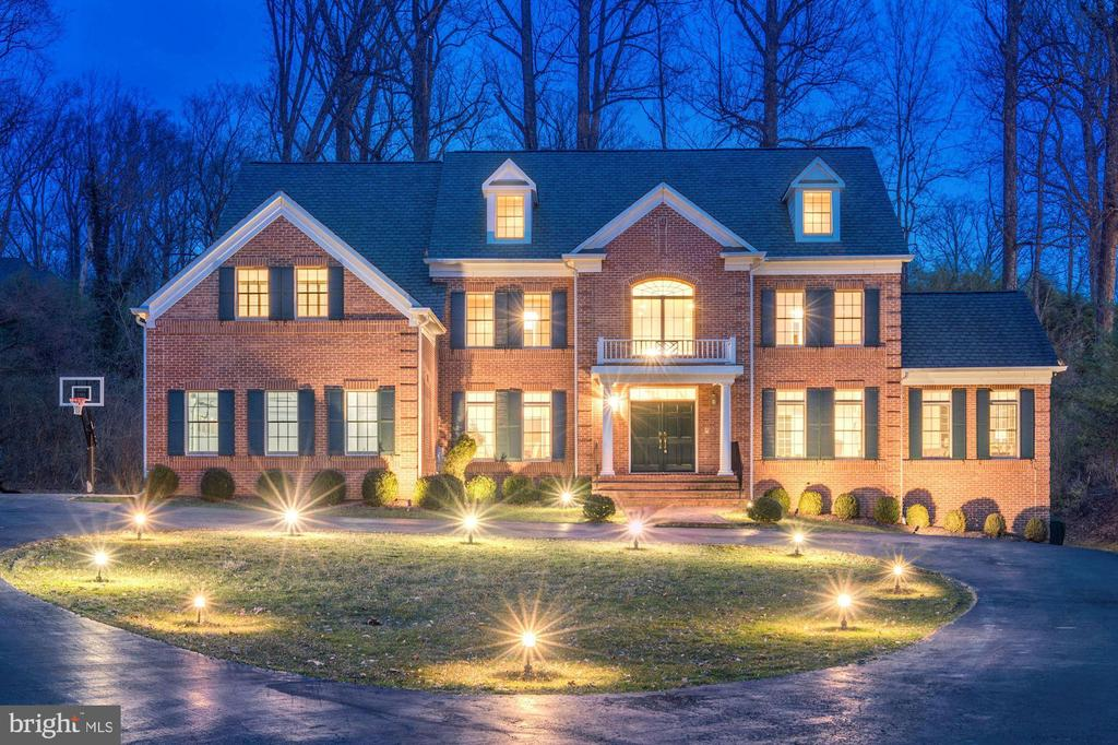 This stunning 6 BD/6.5BA boasts 7550 SF of finished space on 3 levels. The open floor plan is versatile with 2-story living room, gourmet kitchen w/granite countertops, & sunroom w/ surrounding windows. Master BR complete with dual sided FP, spa-like bath and 2 WIC. Lower level finished w/ 2 BR & BA's, expansive rec rm w/FP. Large deck with mature trees, ideally close to I-495 this house provides quick access to major commuter routes, shops, and restaurants.