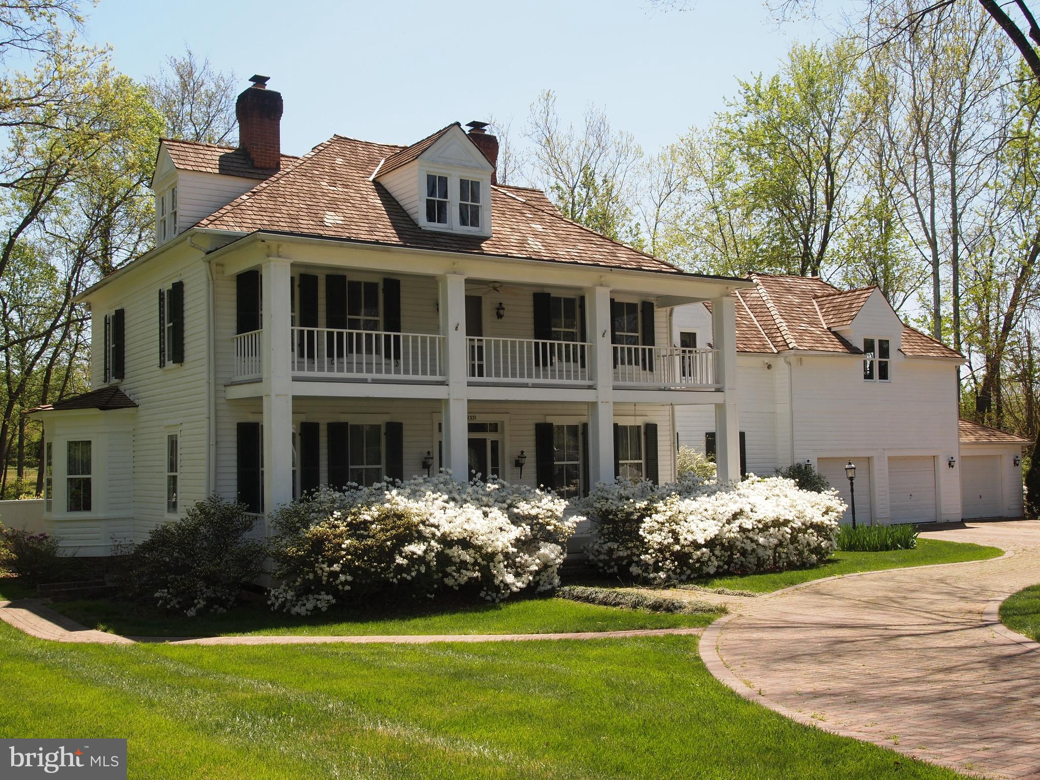 Built in 1898 and once the Burke Hotel, this plantation estate was moved to it's current location in 1981. Home has been restored, renovated and remodeled to include all new finishes, equipment and appliances  Exterior is yellow pine German siding and roof is  cedar shingles; interior includes heart pine wood flooring, 3 fireplaces ( 2 gas & 1 electric); kitchen has Carolina handmade bricks with colonial mortar, mahogany granite, wood cabinets, 2 dishwashers, 2  washer & dryer sets;  lower level has full bath, bedroom, and kitchenette with separate exit; many more unique features; Sited on a beautiful .91 acres with a pool; 3 car garage attached + 2 car garage detached; well maintained on a quiet street; close to VRE, bus routes,Springfield Metro; MUST SEE!