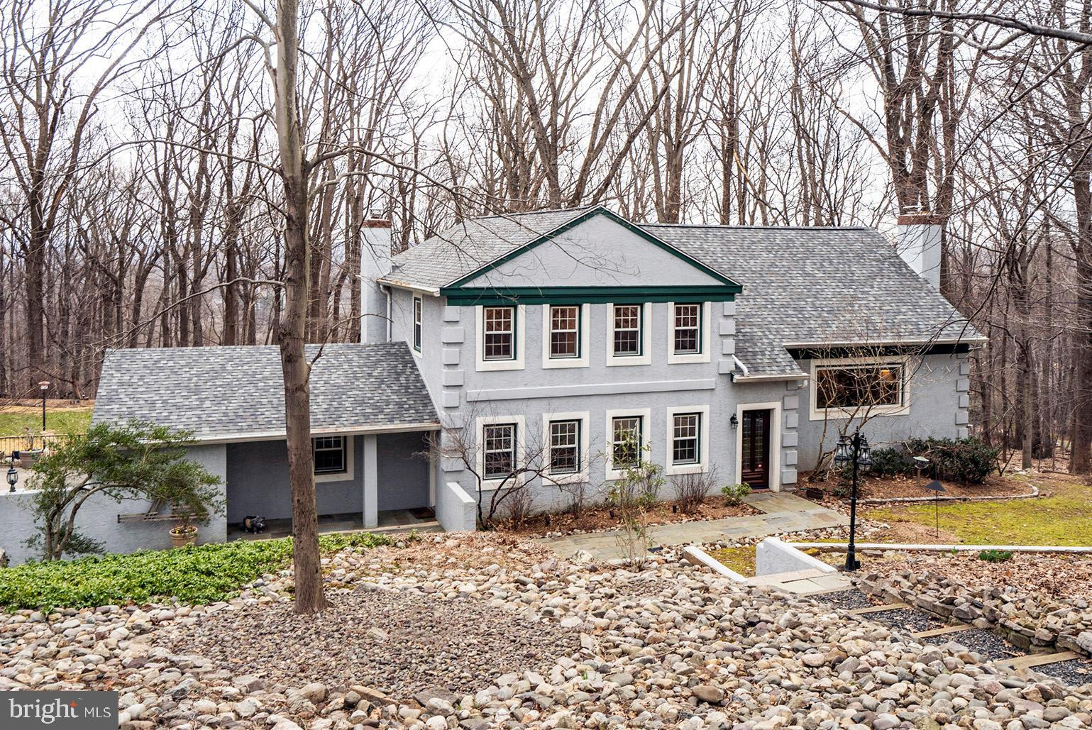 This stunning and completely renovated home is located on historic Valley Forge Mountain. It is situated on a large, partially wooded lot with a level yard on a cul-de-sac street. You will be immediately impressed by the panoramic views overlooking Valley Forge National Park and the Freedom Foundation Flag. Positive and loving energy can be felt throughout this home from the various living spaces and Cook's Kitchen to the 1800 sq ft multi-level deck and mature gardens, there is plenty of room for the whole family to enjoy. Enter in the Foyer with marble floors and double coat closet that leads you to the formal living room with brick fireplace and wood mantel. The flowing floor plan continues into the dining room that features a dramatic chandelier encircled by recessed lighting for a wonderful ambiance. All windows throughout have been replaced with clear Pella windows that provide views from every room. The dining room is open to the kitchen with custom soft close cabinetry, granite counters, Viking dual fuel stove and convection/microwave ovens, Subzero refrigerator and wine refrigerator. Step down to the cozy family room with Vermont Castings fireplace and sliding door that leads to the deck. The convenient laundry room with access to the garage and marble tiled powder room complete this level. The finished (partial daylight) walkout basement has a wet bar and an office area. Upstairs you will find four spacious bedrooms (one of which is a Prince/Princess Suite with a private bath with a Jacuzzi tub). The upper level expanded Master Bedroom features his & her walk-in closets and a luxurious bath with a walk-in marble shower. There are too many other improvements to mention but some include: full house generator, hardwoods and tons of storage throughout, newly stained deck, new roof, garage door, HVAC systems and water heaters. Valley Forge Mountain offers an association that residents can choose to join. Enjoy wonderful social events throughout the year! It offers a private swim club, playground, Racquet Club and so much more. Valley Forge Mountain is truly a unique place to call home. This harmonious property is truly one-of-kind.