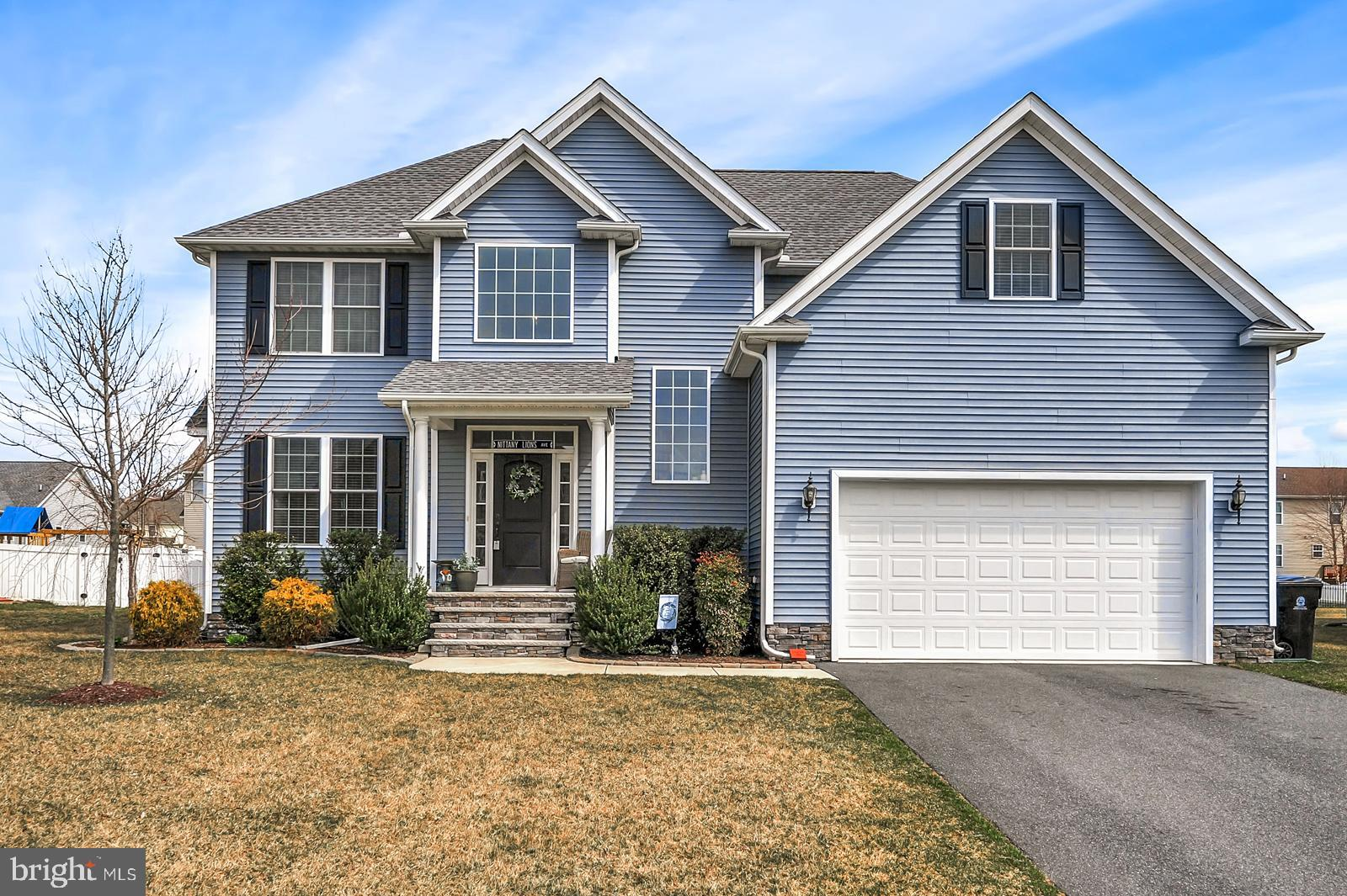 This home is a SHOW-STOPPER!  Welcome to the sought-after neighborhood of Laureltowne in the award winning Caesar Rodney School District.  This 5 year young, C&M built home has pulled out all of the stops.  With over 3,100 square feet and a full basement, there is room for everyone and then some.  As you enter into the home from the covered porch, you and your guests will be impressed by the beautifully appointed open curved staircase with rod iron spindles.  The real hardwood floors in the foyer extend throughout the entire home.  On your left is a formal living room/front room with a gas fireplace and mantle waiting to be decorated for each holiday.  Connected to this room is the formal dining room.  The right side of the home has an open concept feel with a large family room, kitchen, and morning room.  The kitchen boasts stunning white cabinetry with granite countertops, stainless steel appliances, kitchen island, pantry, and a gas range.  The adjacent morning room allows for the perfect amount of sunshine with its abundance of windows and sliders to the backyard.  Upstairs you will find 4 appropriately sized guest bedrooms, all with overhead lights.  The last bedroom is the master suite, and you will fall in love.  The bedroom has tray ceilings, recessed lighting, ceiling fan, an enormous walk-in closet (with two insulated storage rooms), and of course an equally impressive bathroom to go with it!  The master bathroom is fully tiled with separate his/her vanities, corner garden tub, and a glass enclosed shower.  WOW!   Head all the way downstairs into the unfinished basement and you have over 1300 sqft of extra space.  Owners have used this as a play room, workout area, workshop; the possibilities are endless! Out back the show doesn~t stop.  Relax in your own outside oasis as a maintenance free deck leads to a stone patio with a built-in firepit.  All of this overlooks the well-maintained fenced-in yard.  Other features you will love about this home: lawn irri