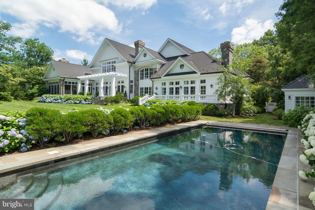 This exclusive waterfront, one of the finest in Annapolis, is located in the lush Melvin Road enclave where Little Aberdeen Creek branches off the South River.  The spectacular, custom-built Maryland Manor House is sited perfectly on 7.9 acres of one of the most prominent points of land on Melvin Road. Designed by the notable architect, Scarlett Breeding, and built by West River Builders, Silver Maple Manor offers timeless features and a lifestyle unlike any other.  beautiful tailored gardens, a heated in ground salt-water pool, a pool house, covered screen porch, three (3) stall barn, ample acreage for horses, fields, three (3) deep water piers and a Yachtsman~s dream boathouse on the protected Little Aberdeen Creek.  A perfect spot to enjoy all the magical seasons of living on the South River. You know you~ve arrived once you turn onto the graceful, winding driveway, lined with Silver Maples. Flowering azaleas, and ornamental grasses overflow from the gardens. The estate~s crisp white facade quickly comes into view~just as the verdant landscaping provides a natural camouflage and ensures total privacy for your weekend - or full time - escape. Perfect for holiday celebrations, weekend house parties, and all types of celebrations, the Manor was designed for entertaining on a large scale.  The gracious proportions of rooms, its elliptical Great Lawn perched by the water's edge; a stunning screened porch and the lovely outdoor dining area offer an easy flow for dozens or even hundreds of guests.  And this quiet sanctuary offers surprisingly close proximately to DC and Baltimore and an easy 3.4 miles drive to downtown Annapolis.
