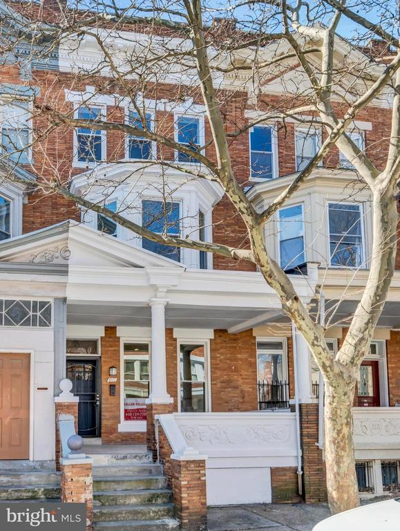 This beautiful, new 5 bedroom renovation in Reservoir Hill features over 3000 square feet of attention to detail! The third floor features a dry bar/lounge area with access to a spacious roof deck. Three bedrooms have their own private full bathrooms; 6 bathrooms total including a deep soaking tub in one! The kitchen features gorgeous quartz countertops, an island with breakfast bar, a built-in wine cooler fridge, and new stainless steel appliances. High ceilings and plenty of windows invite lots of natural light into this rowhome. This house has central A/C, gas heat, stackable washer/dryer, and a private, off-street parking pad in the rear. The photos truly don't do it justice; come check it out in person!