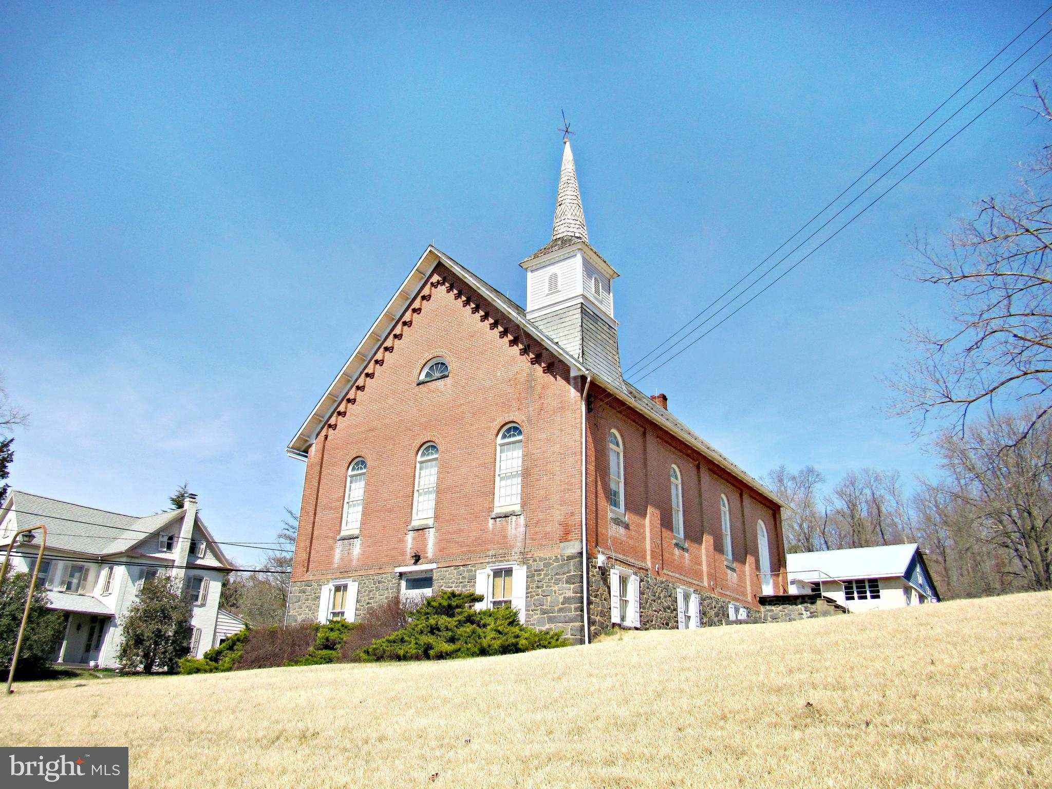 Wonderfully maintained chapel built in 1898. Upper level is a worship area that is 34' x 45' plus large stage. Current seating for approximately 175. Lower level meeting room is 32' x 34'. Lower level also has entrance foyer with two stairways heading to upstairs, heater room and storage room. Building has heat but no interior plumbing. Use your imagination. Many possible uses. Current zoning Borough Residential which does permit professional office and some commercial uses. Call listing agent for details.