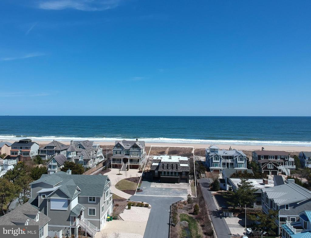 With 75 feet of pristine Oceanfront, this classic beach retreat is the last original residence within the highly desirable community of Dukes Dune.  Positioned on an over-sized lot among 4 newly constructed luxury homes, this is one of the most sought-after locations on the Delaware Coast.  This property offers the unique ability to construct a sizable home with the option for a private pool while capturing unobstructed ocean views as well as evening sunset vistas over the Salt Pond.  Enjoy direct beach access from your personal boardwalk to a quiet, secluded beach while maintaining the convenience of being just a short walk into town.