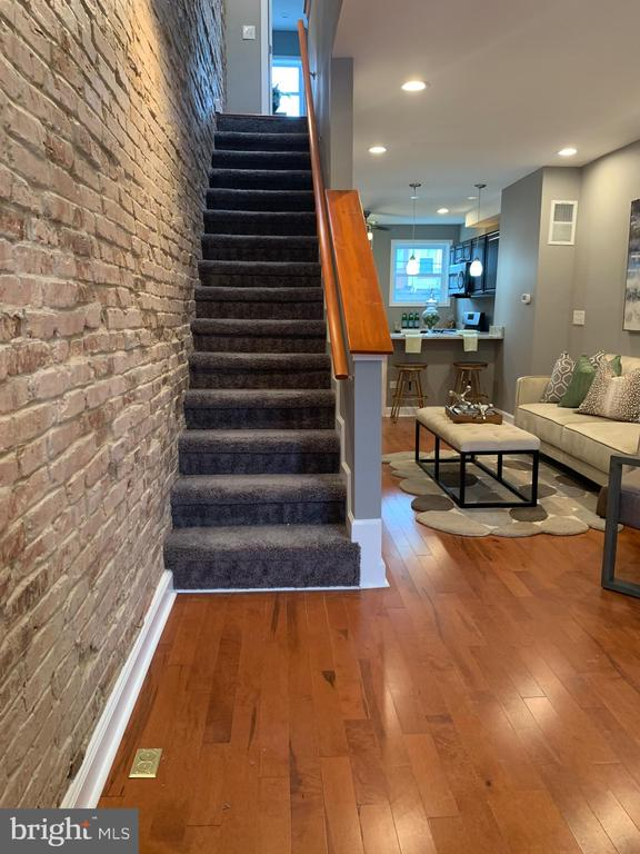 Wow, this newly renovated home has all new features and updates. New heating and a/c with updated kitchen wood and ceramic floors.  All new stainless steel appliances with central air conditioning and heat. This is a must see!